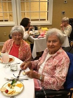 Two Skilled Nursing residents enjoy the Summer Party