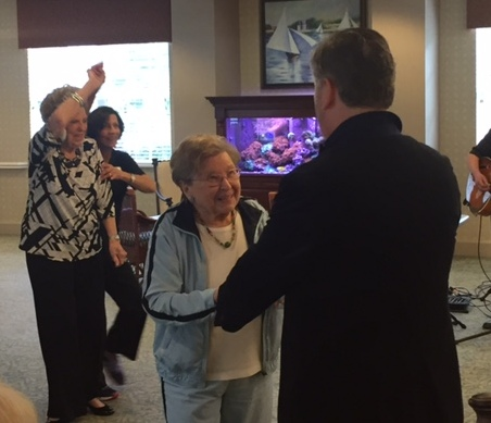 Residents dancing during happy hour at McKnight Place Assisted Living