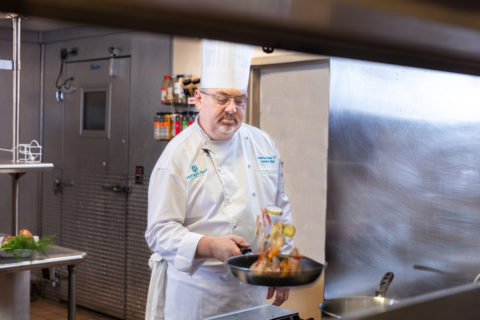 Executive Chef Lyons cooking in kitchen