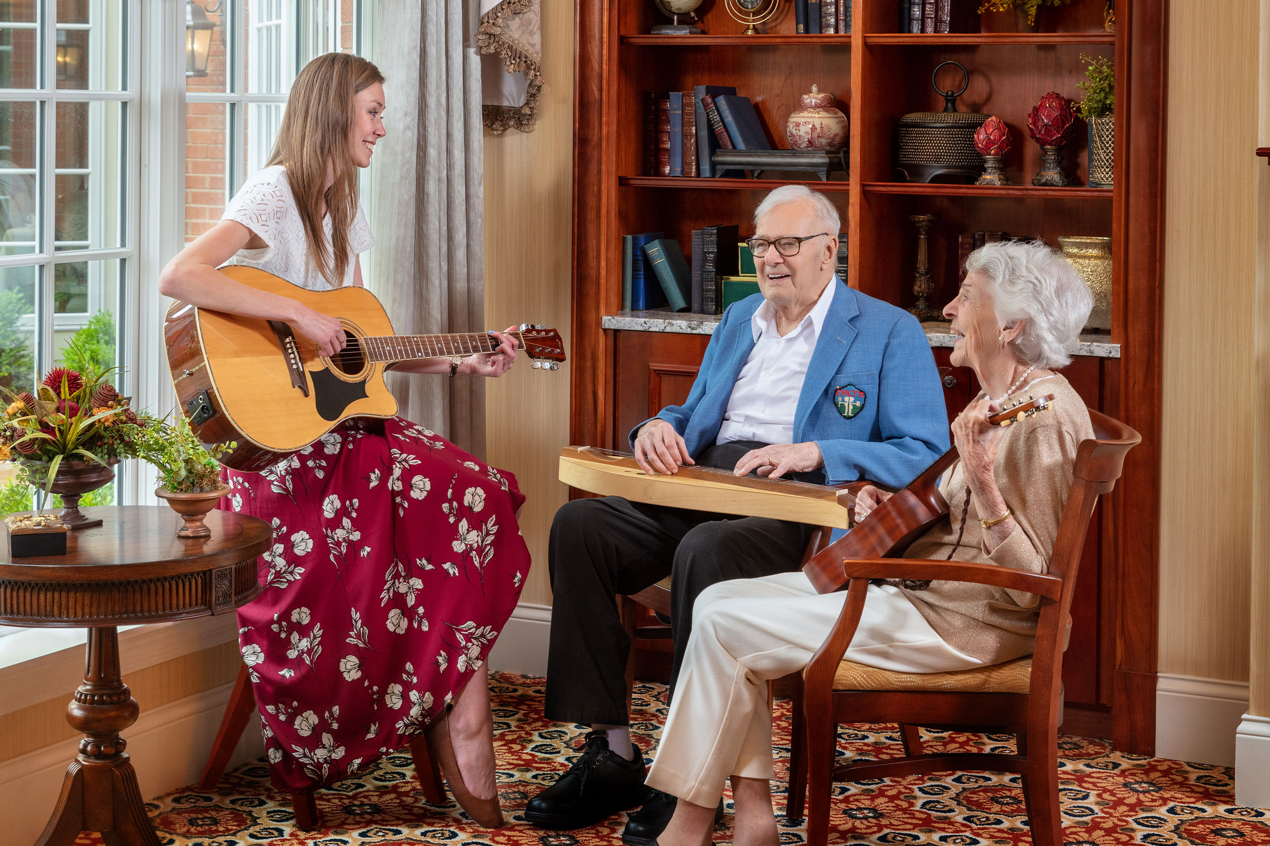 Music Therapist in a lesson with residents.