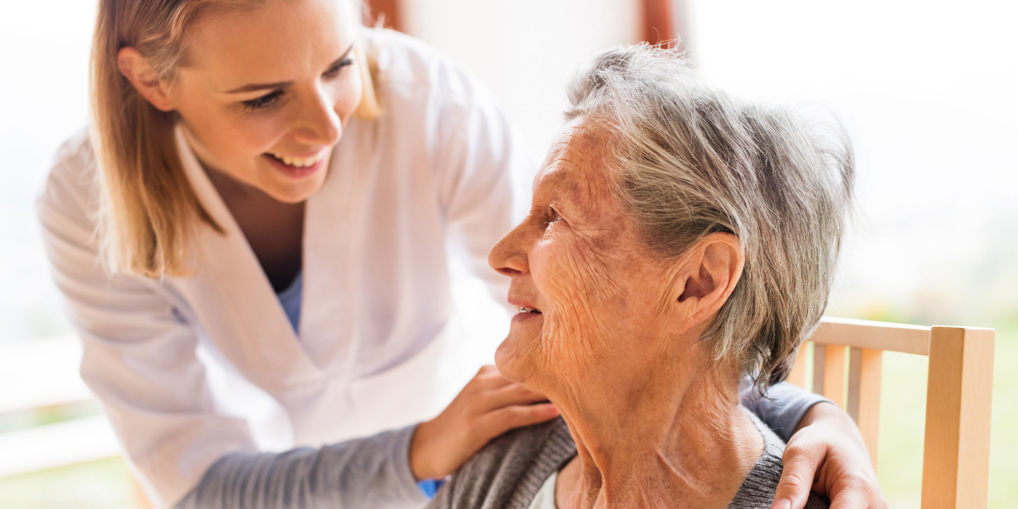 Nurse and a senior woman during checkup.