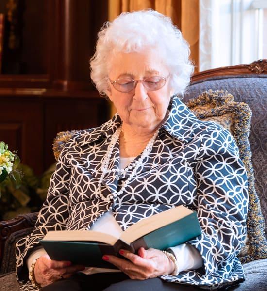 senior resident reading.