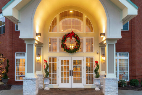 Front Entrance of McKnight Place Assisted Living and Memory Care decorated for the holidays.